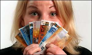Woman holds up a deck of euros