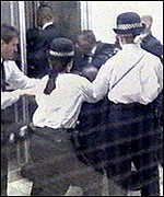 [ image: Police struggle with Nation of Islam members]
