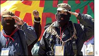 Comandante Abraham and Subcomandante Marcos attend the Nurio conference