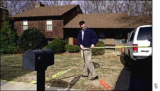 The FBI searches Robert Hanssen's home in Virginia