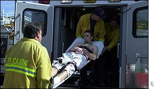 wounded student is carried into ambulance