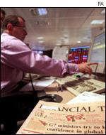 City trader looks at his screen