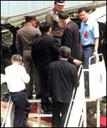 Thaksin examines plane wreckage