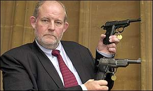 Home Office Minister Charles Clarke shows confiscated replica weapons