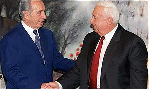 Shimon Peres, left, and Ariel Sharon