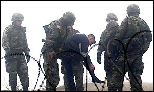 US K-For troops check ethnic Albanian man