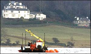 The barge passing former home of John ruskin on lakeside