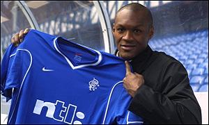 Marcus Gayle shows off his new team colours