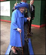 The Queen Mother walks over a disinfectant mat at Sandown Park races in Surrey