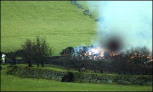Carcasses being burned at Dunnabridge Farm, near Dartmeet on Dartmoor