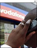 Mobile phone user outside a Vodafone store