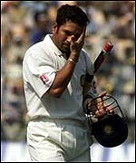 Sachin Tendulkar walks off after being dismissed