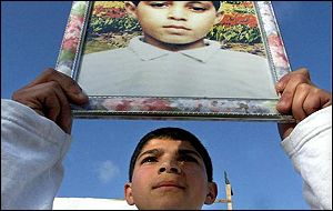 Brother of slain Muhammad al-Durrah holds his portrait