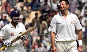 Australia's Michael Kasprowicz can't believe it following another Laxman boundary
