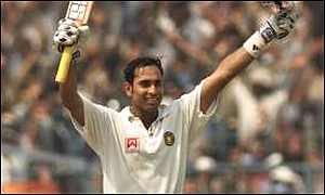 Laxman celebrates after getting his double century
