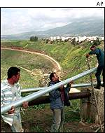 Lebanese workers lay water pipe