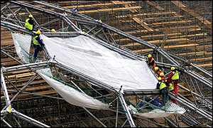 The first roof panel being installed in January 2000 - Apex Photos