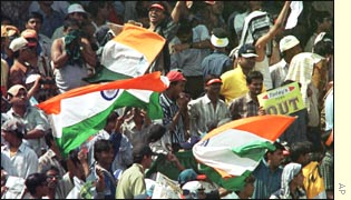 Supporters celebrate as India win the Calcutta Test