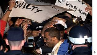 Sean Combs walks through the crowd after being cleared
