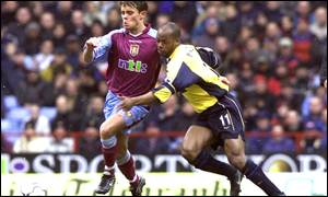 Lee Hendrie (l) tussles with Arsenal's Sylvain Wiltord
