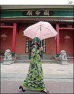 Buddhist temple with Muslim woman