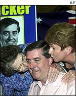 Liberal candidate Bob Tucker is kissed by his mother and wife