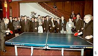 Kissinger playing ping-pong with Vice-Premier Li
