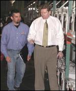 Don Cowan (right) and Daniel Larks (left) warehouse manager in the warehouse where assets are stored for viewing before the auction.