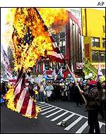 Daewoo workers in South Korea burn a US flag t