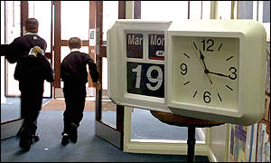 students leaving past clock