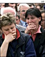 Macedonian women cry during a protest rally in Skopje on 18 March