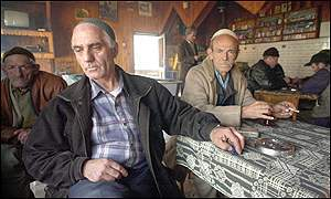 Villagers in a cafe in Selce, Macedonia, where the NLA has its headquarters for the Toto region