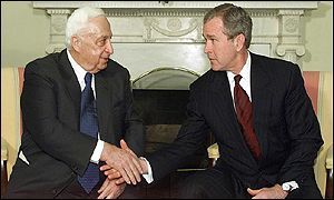 Ariel Sharon and George W Bush shake hands