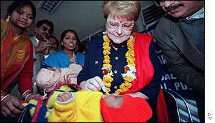 Dr Gro Harlem Brundtland, Dirctor-General, World Health Organisation, administers a polio vaccine.