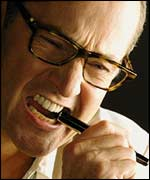 Man chewing a pen
