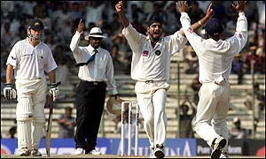 Harbhajan Singh celebrates another wicket while Steve Waugh looks on