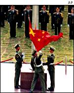 PLA officers hoist flag
