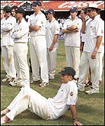 Australia gather on the Chennai pitch after defeat in the third Test
