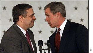 CIA Director George Tenet (L) and President George W Bush