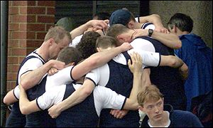 Oxford's crew huddle together in commiseration