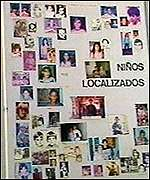 A board with pictures of the children who have been found