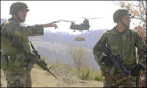 US troops patrol near Tanusevci along the Kosovo-Macedonian border