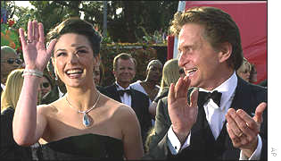 Husband and wife Catherine Zeta Jones and Michael Douglas greet the fans