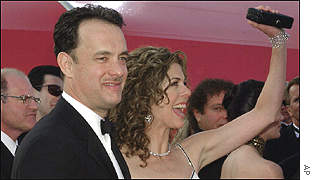 Best actor nominee Tom Hanks arrives with wife Rita Wilson