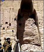 Taleban officials stand in front of a completely destroyed Buddha in Bamiyan