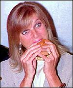 Linda tucks into a meat free burger