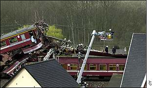 Emergency services use cranes to search the wreckage