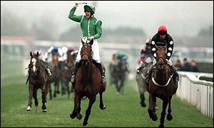 Jockey Ruby Walsh celebrates as Papillon (l) is first past the post at the 2000 Grand National