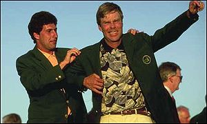 Ben Crenshaw puts on the Green Jacket presented by Jose Maria Olazabal