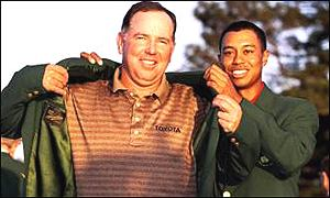 Tiger Woods presents 1998 Masters champion Mark O'Meara with the Green Jacket